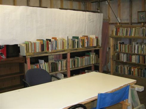 A readers' table, and some of the around 3,000 books in the PANZA archive